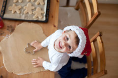 Adorable little boy, preparing cookies for christmas Royalty Free Stock Photo