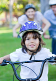 Adorable little boy riding a bike. In a park Stock Images