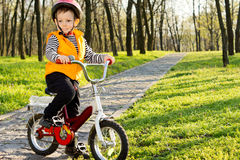 Adorable little boy riding his bike Stock Photography