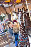 Family at the amusement park Royalty Free Stock Photos