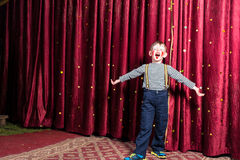 Adorable little boy singing on stage during a play Royalty Free Stock Images