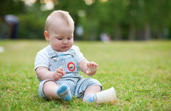 Adorable little boy sitting Stock Image