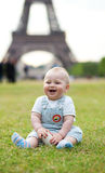 Adorable little boy sitting on the grass Royalty Free Stock Images