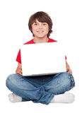 Adorable little boy sitting with laptop Stock Images