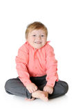 Adorable little boy smiling, sitting on the floor, Stock Images
