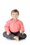 Adorable little boy smiling, sitting on the floor, Royalty Free Stock Image