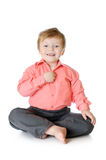 Adorable little boy smiling, sitting on the floor, Stock Image