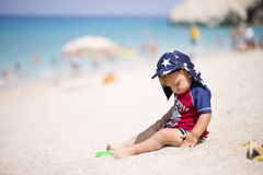 Adorable little  boy  in swimsuit  at tropical beach Stock Image
