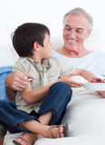 Adorable little boy taking care of his grandfather Stock Photo