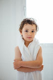 Adorable little boy with white towel. Portrait of cute calm little boy with wet hair after shower looking at camera Royalty Free Stock Images