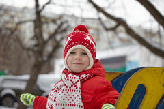 Adorable little boy in winter park Stock Image