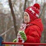 Adorable little boy in winter park Stock Photos