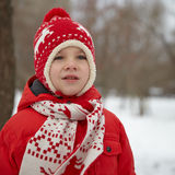Adorable little boy in winter park Royalty Free Stock Image