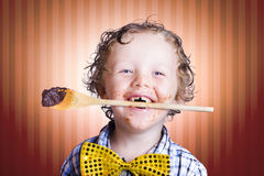 Adorable Little Boy Cooking Chocolate Easter Cake Royalty Free Stock Photo