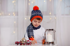 Adorable little boy, writing letter to Santa Stock Image