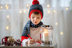 Adorable little boy, writing letter to Santa Royalty Free Stock Photography