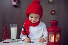 Adorable little boy, writing letter to Santa Stock Photos