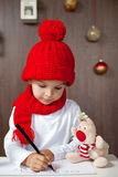 Adorable little boy, writing letter to Santa Stock Photo