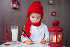 Adorable little boy, writing letter to Santa Royalty Free Stock Image