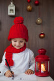 Adorable little boy, writing letter to Santa at home Royalty Free Stock Photography