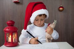 adorable little boy writing letter to santa stock images
