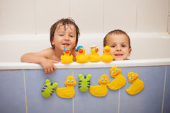Adorable little boys in bathtub with his rubber duckies Royalty Free Stock Photos