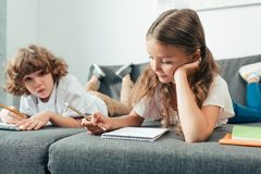 adorable little brother and sister doing homework together royalty free stock photos