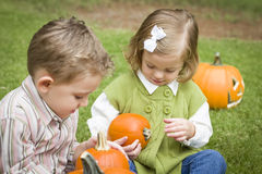 Adorable Little Brother and Sister At the Pumpkin Patch Stock Photos