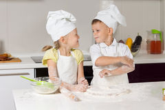 Adorable Little Chefs Playing at Kitchen Stock Image
