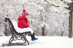 Adorable little child, boy, playing in a snowy park, holding ted Royalty Free Stock Image