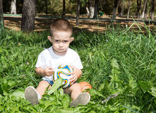 Adorable little child boy with soccer ball in park on nature at summer Royalty Free Stock Photography