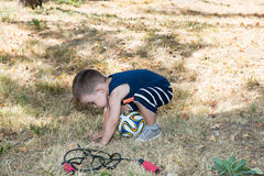 Adorable little child boy with soccer ball in park on nature at summer. Stock Images