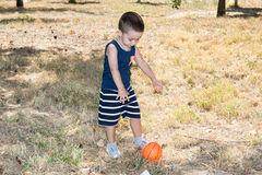 Adorable little child boy with soccer ball in park on nature at summer. Stock Image