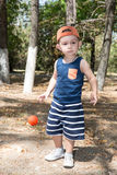 Adorable little child boy with soccer ball in park on nature at summer Stock Photography