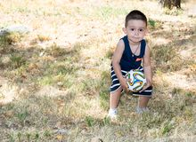 Adorable little child boy with soccer ball in park on nature at summer. Royalty Free Stock Photo