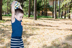 Adorable little child boy with soccer ball in park on nature at summer. Royalty Free Stock Images