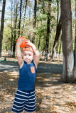 Adorable little child boy with soccer ball in park on nature at summer Stock Photo