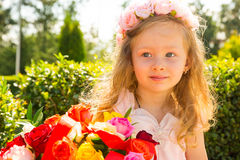Adorable little child girl with bouquet of flowers on happy birthday. Summer green nature background. Use it for baby, parenting royalty free stock photos