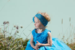 Adorable little child girl on grass on meadow. Summer green nature background. Royalty Free Stock Photos