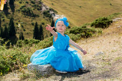 Adorable little child girl on grass on meadow. Summer green nature Royalty Free Stock Images