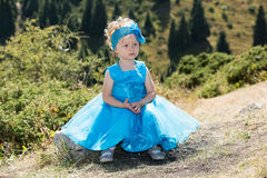 Adorable little child girl on grass on meadow. Summer green nature . Royalty Free Stock Image