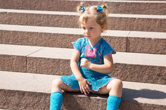 Adorable little child girl on stairs on nature. Stock Images