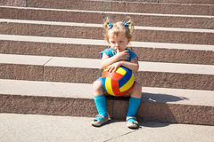 Adorable little child girl with toy ball in park. Use it for baby, parenting or love concept Royalty Free Stock Photo