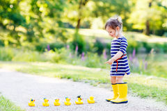 Free Adorable Little Child Of 2 Playing With Yellow Rubber Ducks In S Stock Images - 51177604