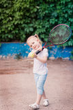 Adorable little child playing tennis Royalty Free Stock Photos