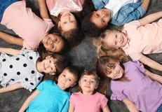 Free Adorable Little Children Lying On Floor Together Indoors. Kindergarten Playtime Activities Stock Photography - 158567822