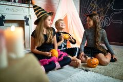 Smiling Kids with Carved Pumpkins stock photos