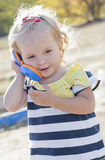 Adorable little cute girl with phone. Adorable little cute girl with a toy phone stock photo