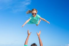 Adorable little daughter and her happy father having fun outdoor Royalty Free Stock Photography