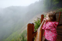 Adorable little enjoing the view on rainy day Stock Images
